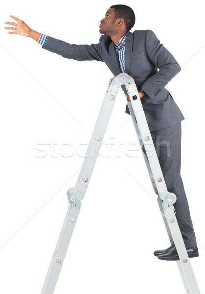 Businessman climbing up ladder Stock photo © wavebreak_media