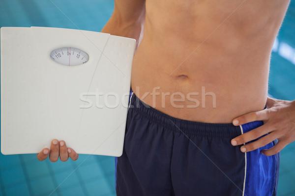 Fitt férfi úszik alsónadrágok áll medence Stock fotó © wavebreak media 43637ce0d7