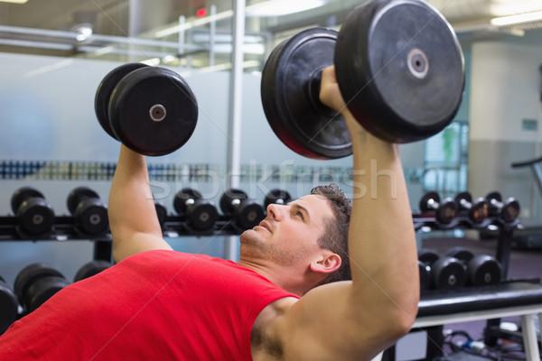 Bodybuilder banc haltères gymnase club Photo stock © wavebreak_media