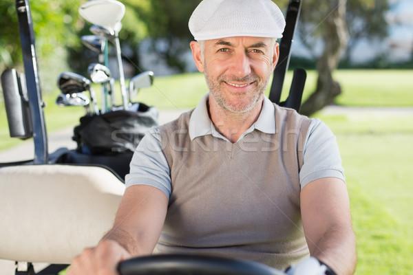 Feliz jogador de golfe condução golfe sorridente câmera Foto stock © wavebreak_media