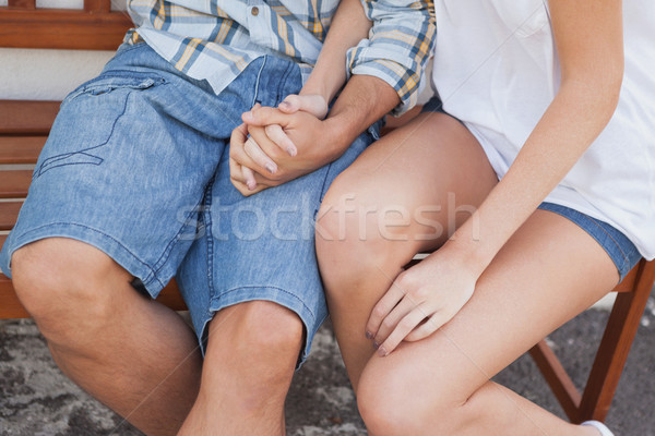 Young hip couple sitting on bench Stock photo © wavebreak_media