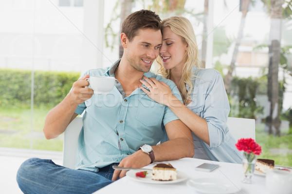 Hip young couple enjoying coffee and desert together Stock photo © wavebreak_media