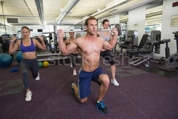 Fitness class lifting barbells together Stock photo © wavebreak_media