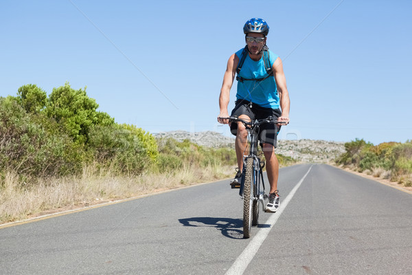 Athletic man cycling on open road  Stock photo © wavebreak_media