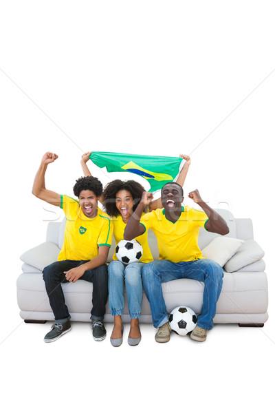 Futbol fanlar sarı kanepe beyaz Stok fotoğraf © wavebreak_media