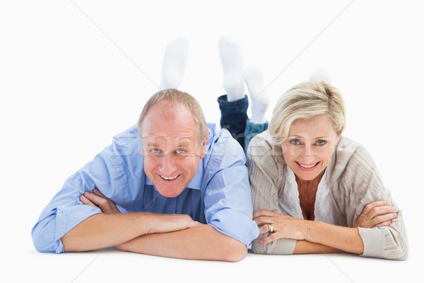 Happy mature couple lying and smiling Stock photo © wavebreak_media