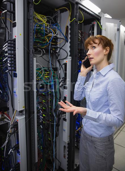 Technician talking on phone while analysing server Stock photo © wavebreak_media