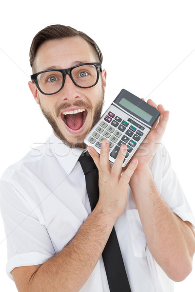 Nerdy excited businessman showing calculator Stock photo © wavebreak_media
