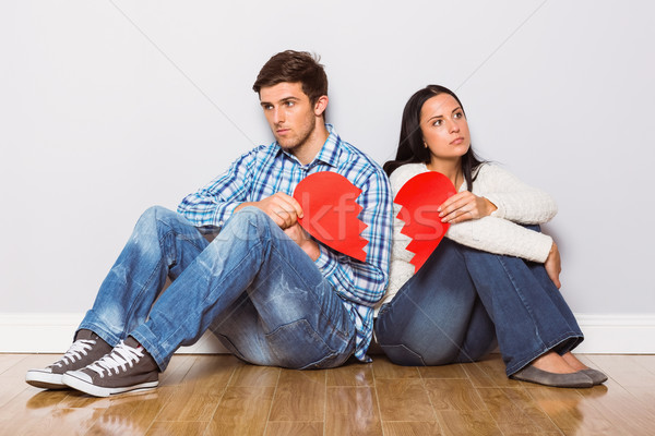 Young couple sitting on floor with broken heart Stock photo © wavebreak_media