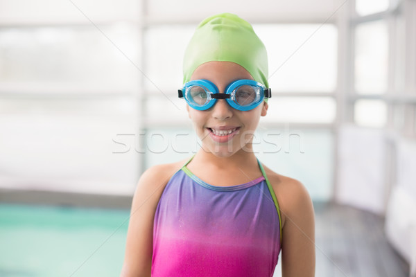 Cute little girl standing poolside Stock photo © wavebreak_media