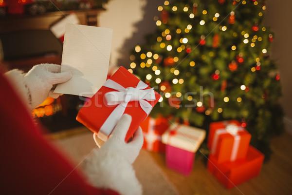 Święty mikołaj papieru dar domu salon Zdjęcia stock © wavebreak_media
