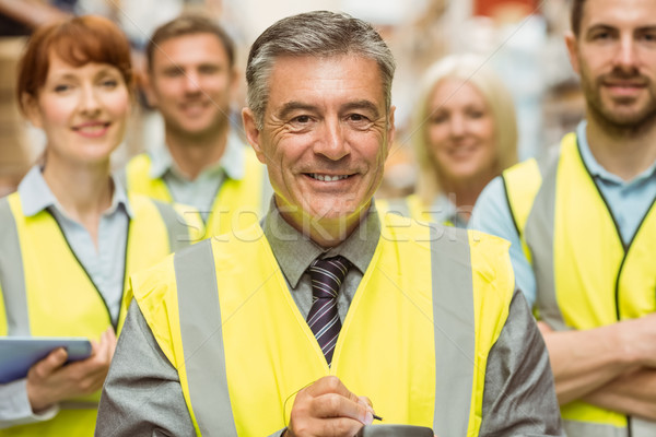 Magazzino squadra braccia incrociate indossare giallo gilet Foto d'archivio © wavebreak_media