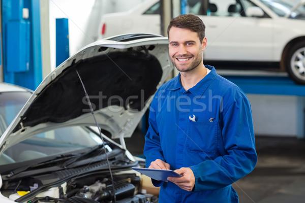 Lächelnd Mechaniker Reparatur Garage Service Stock foto © wavebreak_media