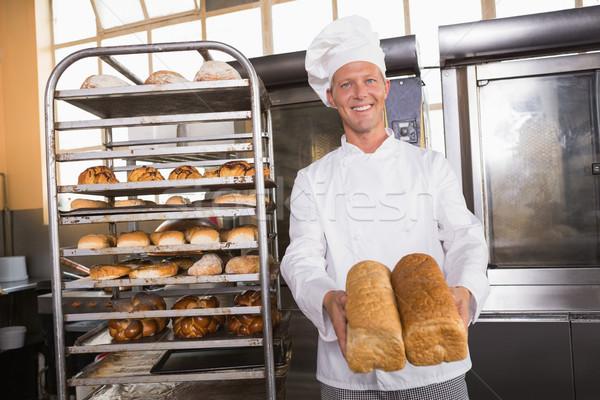 Sonriendo Baker pan cocina panadería Foto stock © wavebreak_media