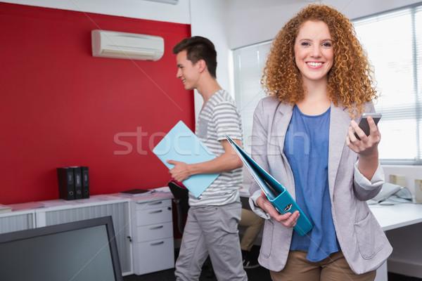 улыбаясь студент смартфон Одноклассники колледжей школы Сток-фото © wavebreak_media