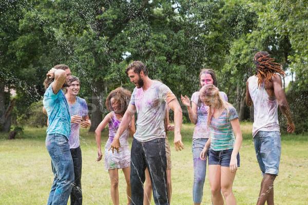 Young friends having fun with powder paint Stock photo © wavebreak_media