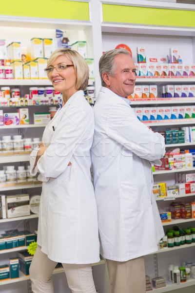 Farmaceuta kolega stałego apteki kobieta Zdjęcia stock © wavebreak_media