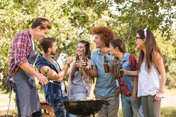 Boldog barátok park barbecue napos idő férfi Stock fotó © wavebreak_media