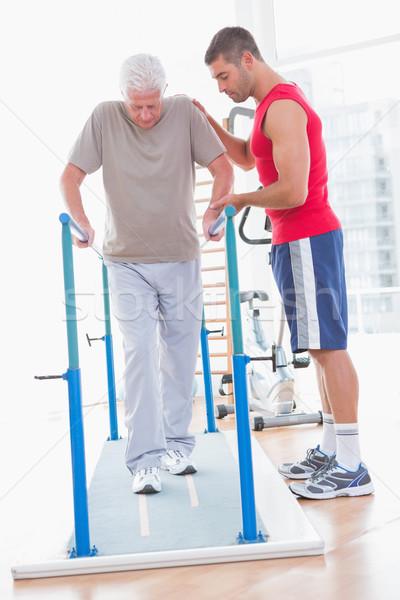 Senior man walking with coach help  Stock photo © wavebreak_media