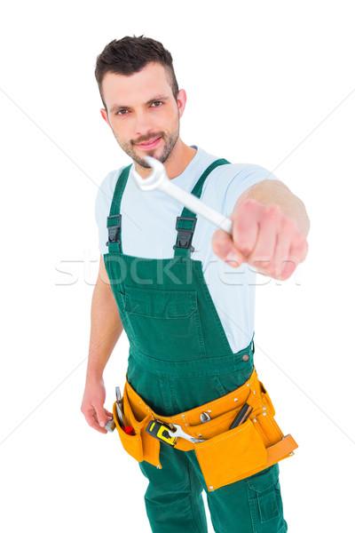 ács mutat franciakulcs fehér férfi boldog Stock fotó © wavebreak_media