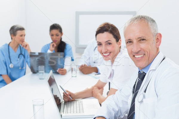 Squadra medici lavoro laptop Xray medici Foto d'archivio © wavebreak_media