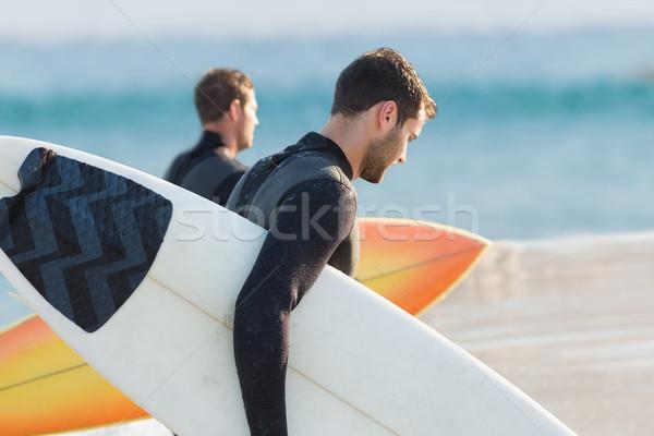 Két férfi szörfdeszka napos idő tengerpart férfi sport Stock fotó © wavebreak_media