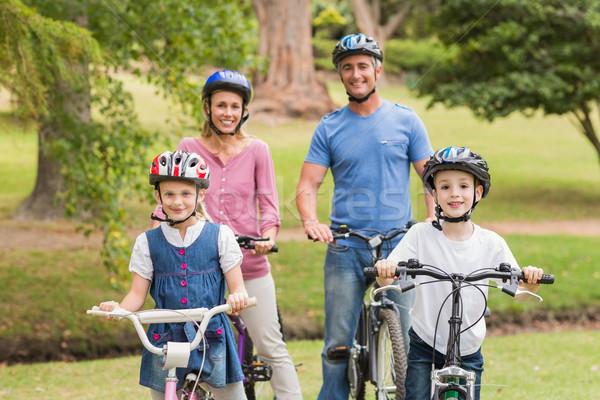 Stock foto: Glückliche · Familie · Fahrrad · Park · Frühling · Mann