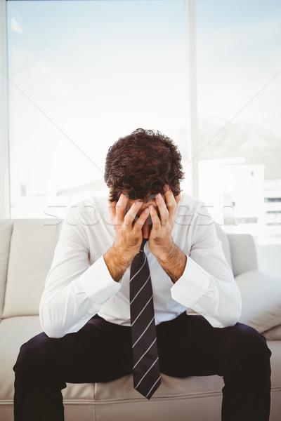 Frustré affaires tête mains séance vers le bas Photo stock © wavebreak_media