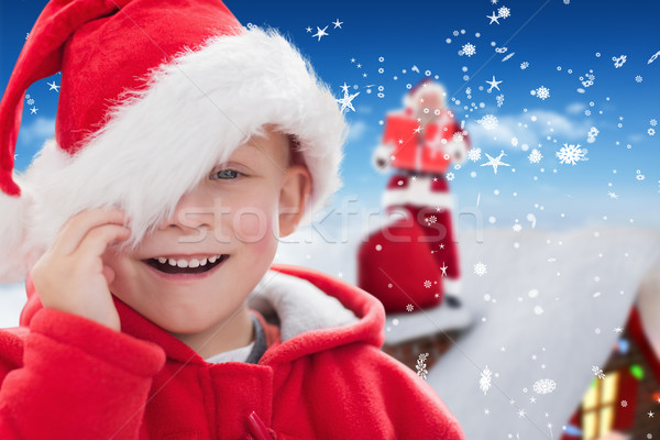 Composite image of cute boy in santa hat Stock photo © wavebreak_media