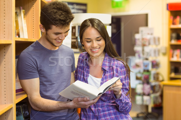 Smiling friends student reading textbook Stock photo © wavebreak_media
