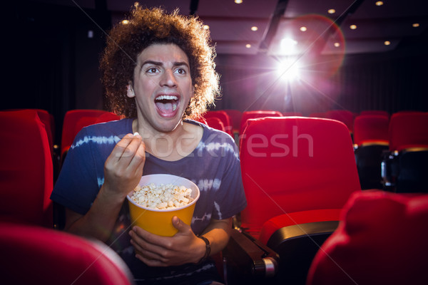 Happy young man watching a film Stock photo © wavebreak_media