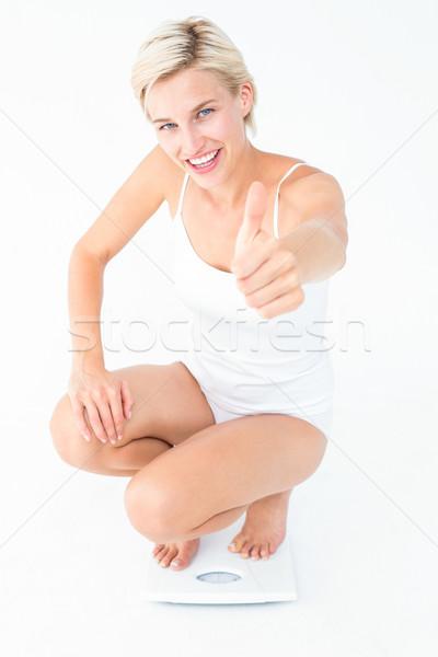 Boldog szőke nő guggol mérleg remek fehér Stock fotó © wavebreak_media