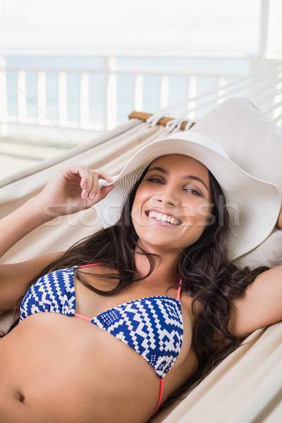 Mooie brunette ontspannen hangmat patio bikini Stockfoto © wavebreak_media