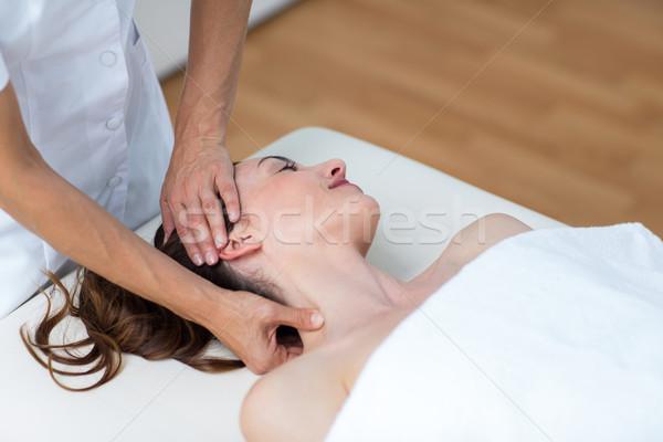 Physiotherapist doing neck massage  Stock photo © wavebreak_media