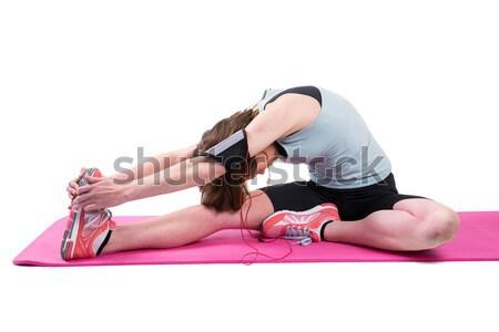 Pretty brunette stretching her leg on exercise mat  Stock photo © wavebreak_media