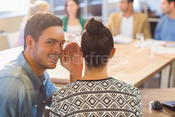 Casual businessman whispering secret to his colleague Stock photo © wavebreak_media