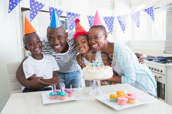 Happy family celebrating a birthday together  Stock photo © wavebreak_media