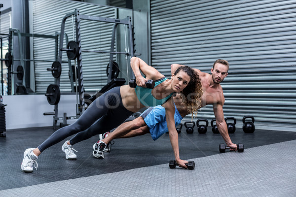 Muscular couple doing plank exercise together Stock photo © wavebreak_media