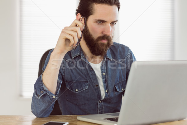 Hipster businessman working on his laptop Stock photo © wavebreak_media