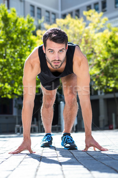 Handsome athlete in running stance Stock photo © wavebreak_media
