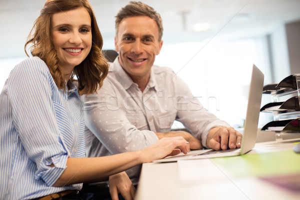 Portrait of business colleagues working together in office Stock photo © wavebreak_media