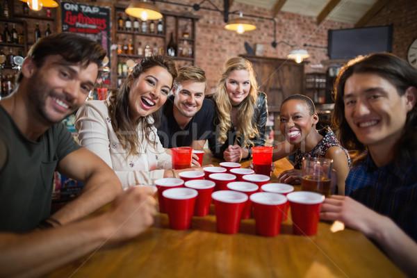 портрет улыбаясь друзей вокруг одноразовый Сток-фото © wavebreak_media