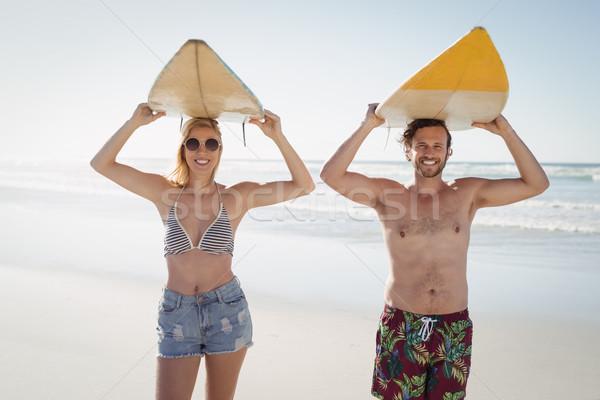 Ritratto felice Coppia tavola da surf spiaggia Foto d'archivio © wavebreak_media