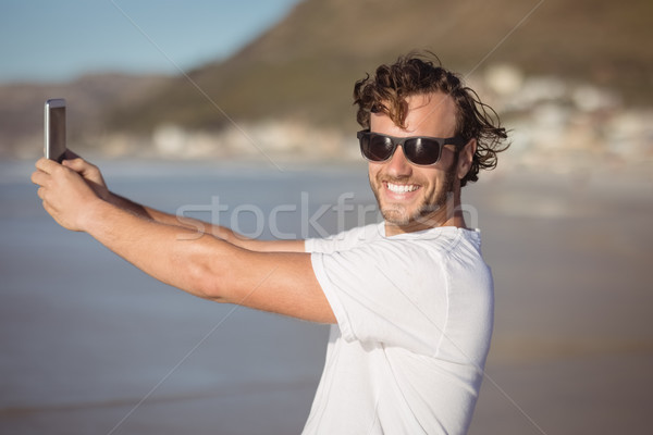 Portré mosolyog férfi elvesz tengerpart napos idő Stock fotó © wavebreak_media
