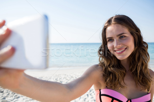 Szczęśliwy młoda kobieta bikini plaży Zdjęcia stock © wavebreak_media