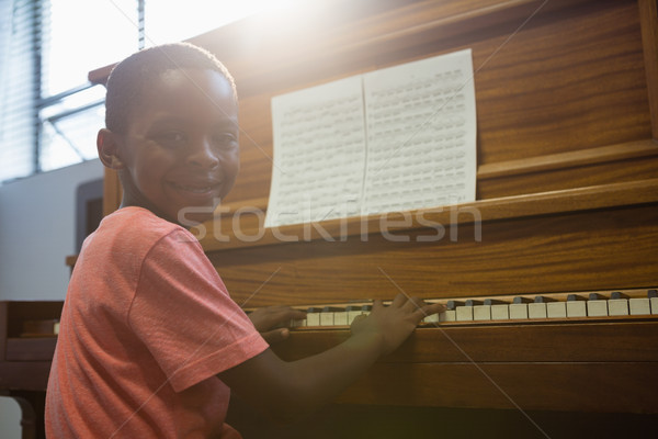 Portrait of boy playing piano in classroom Stock photo © wavebreak_media