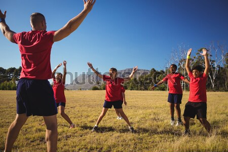 Trainer assisting kids in tug of war during obstacle course training Stock photo © wavebreak_media