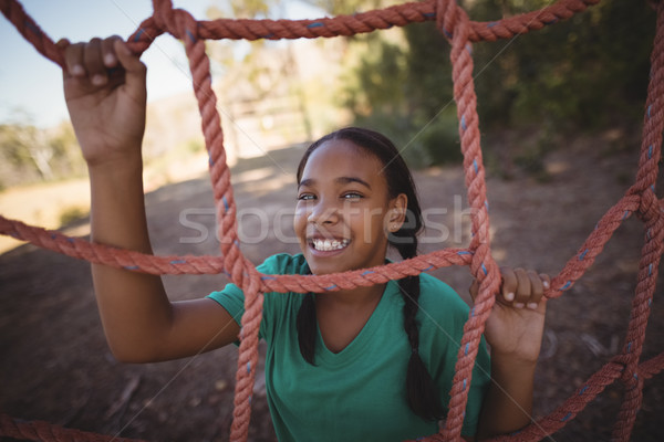 Portrait of happy girl standing near net during obstacle course Stock photo © wavebreak_media