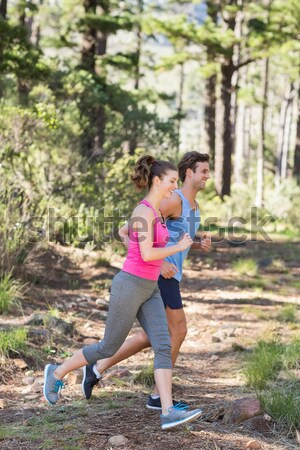 Trainer assisting woman while exercising during obstacle course Stock photo © wavebreak_media