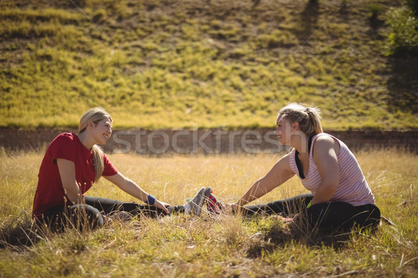 Happy friends performing stretching exercise during obstacle course Stock photo © wavebreak_media